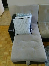 two gray and black fabric sofa chairs