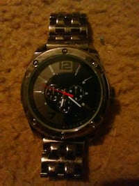 round black analog watch with link bracelet