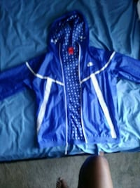 blue and white NIKE zip-up jacket St. Louis, 63121