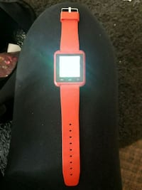 white Apple Watch with red sports band Kitchener, N2G 2P3