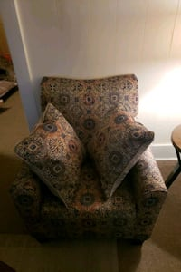 brown and black floral fabric sofa chair 319 mi