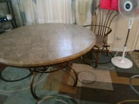 round brown wooden table with four chairs dining set Plainville, 02762