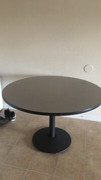 Round black wooden table