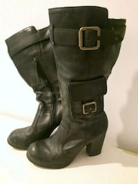 pair of black leather buckled riding boots Montréal, H2K 3R2
