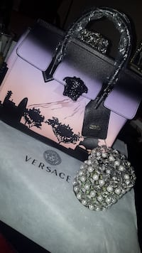 women's black and white leather Versace tote bag