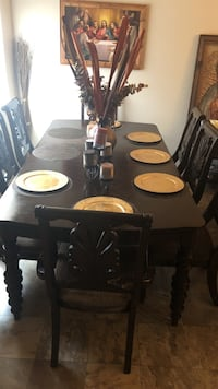 black and brown wooden table with chairs