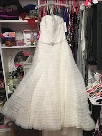 Beautiful wedding dress never been worn - still has price tag ($1500 original price) plus bridal heels that match