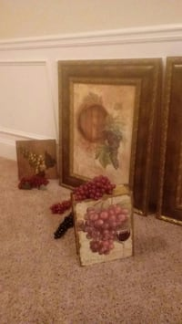 painting of grapes on brown wooden frame