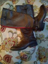 pair of brown leather zip-back buckled knee-high biker boots