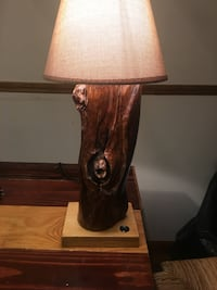 Brown and black wooden table lamp
