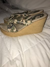 Just got these in only wore them one time. Camouflage slip on wedges