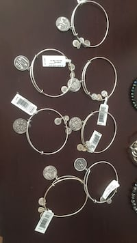 Silver-colored pendant bangles $8 each  Worcester