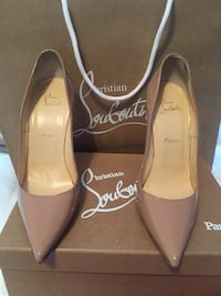 pair of tan Christian Louboutin pointed-toe stiletto shoes with box