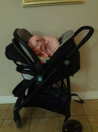 baby's black and gray stroller 723 km