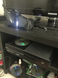 Black xbox one console with two controllers and double charging port Manassas Park, 20111