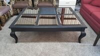 black wooden framed glass-top coffee table