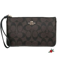 Brand new Coach large wristlet brown/black Port Washington