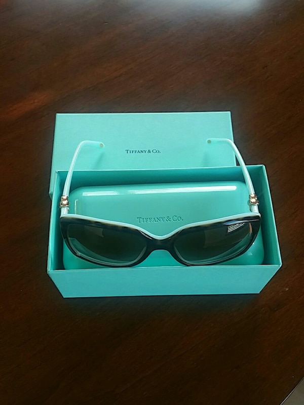8843c3f1f0 Used white framed Tiffany   Co. sunglasses with box for sale in ...
