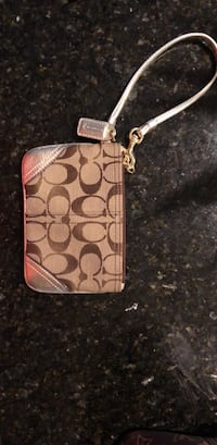brown and black Coach monogram wristlet Odessa, 79761
