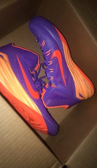 Pair of purple-and-orange nike basketball shoes North Little Rock, 72118