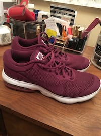 pair of pink-and-white Nike running shoes New York, 10029
