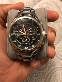 Citizens Watch Eco-Drive H570. This watch is pre-owned and have just a few little scratches on the metal strap. The watch is in good condition besides the visible scratches on the metal strap. Elizabeth, 07206