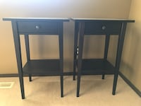 two black wooden single-drawer end tables