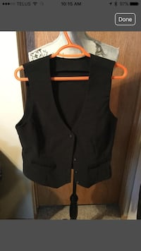 Women's black fashion vest with Buckle on back. Calgary, T3G