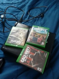 black Xbox 360 game console with game cases Augusta, 30907