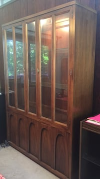 Walnut wood good condition with shelves at the bottom China closet.  Manalapan, 07726