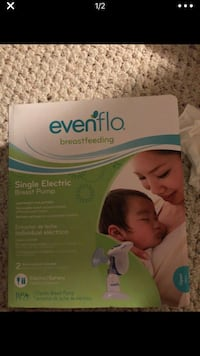 White and green evenflo electric breast pump box 20 km