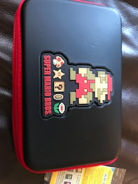 Red and black Super Mario Bros. Nintendo DS pouch, 3DS 3 Games, charger, light use