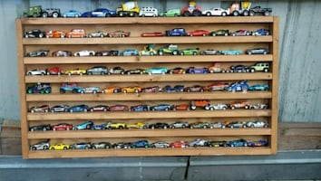 Have 90 Hot wheels with display shelve