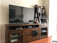 flat screen television with brown wooden TV hutch Washington, 20037