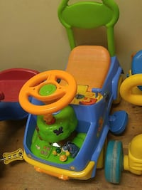 toddler's green, orange, and blue ride-on toy