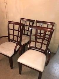 4 wooden padded chairs  New York, 10035