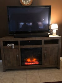 62 in TV stand with Fireplace and stereo system (TV not included)
