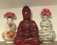three red and brown ceramic figurines