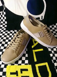 pair of brown leather low-top sneakers with box Montreal, H4N 1K7