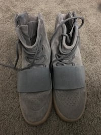 pair of gray high-top sneakers