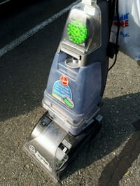 gray and green upright carpet cleaner
