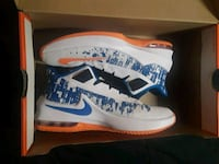 pair of white-and-blue Nike basketball shoes 83 mi
