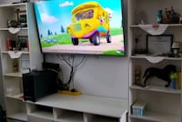 I'm selling my bigTv table with 2 sided bookshelve Montréal, H4B 2N4