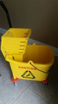 Brand new mop bucket with ringer .  Brampton, L7A 3K3