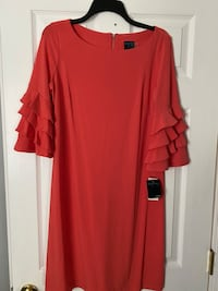 New with tags size 8 coral color ruffle sleeve dress