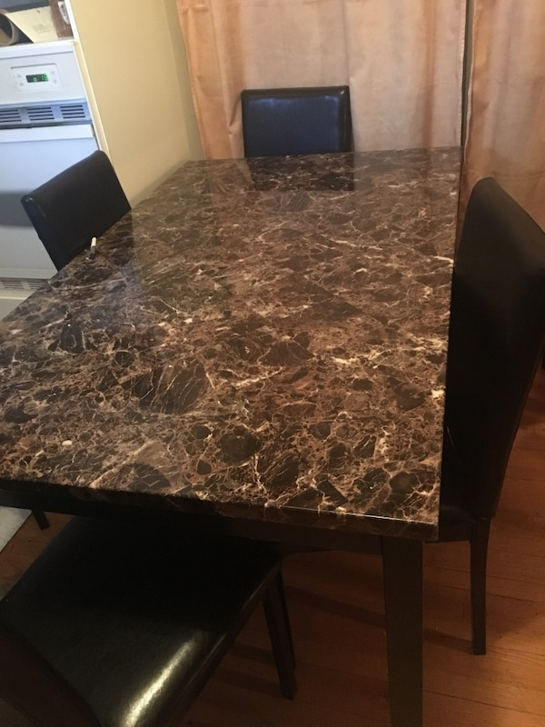 Rectangular brown marble top table with four chairs