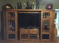 brown wooden TV hutch with flat screen television Niceville, 32578