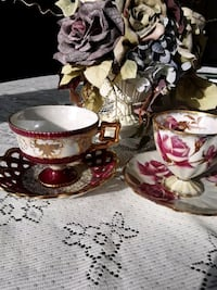 Two fancy cups and saucer