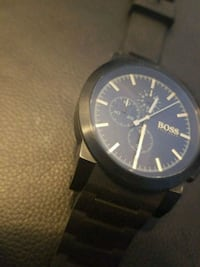 round black chronograph watch with black leather s Vancouver, V6G 0B6