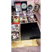 black Sony PS3 slim console with game cases Biggs, 95948
